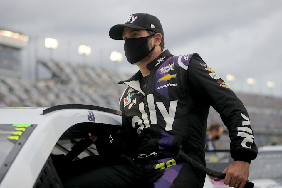 DAYTONA BEACH, FLORIDA - AUGUST 29: Jimmie Johnson, driver of the #48 Ally Chevrolet, climbs into his car prior to the NASCAR Cup Series Coke Zero Sugar 400 at Daytona International Speedway on August 29, 2020 in Daytona Beach, Florida. (Photo by Chris Graythen/Getty Images)