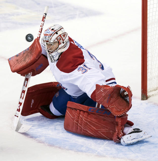 A shot goes wide as Montreal Canadiens goalie Carey Price defends the net during the second period of an NHL hockey action against the Vancouver Canucks in Vancouver, British Columbia, Saturday, Nov. 17, 2018. (Darryl Dyck/The Canadian Press via AP)