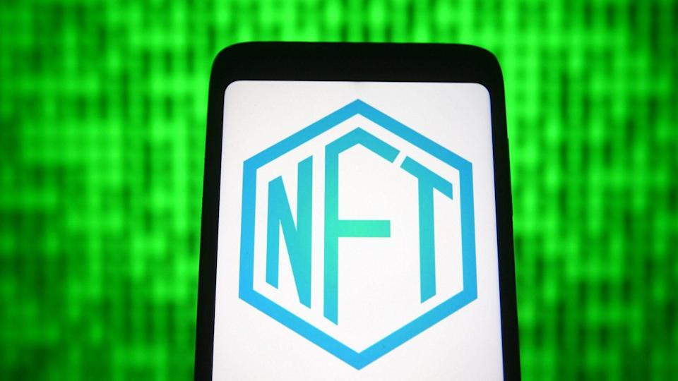 Mandatory Credit: Photo by Pavlo Gonchar/SOPA Images/Shutterstock (11866604s)In this photo illustration a NFT ( Non-fungible token) sign is seen on a smartphone screen.
