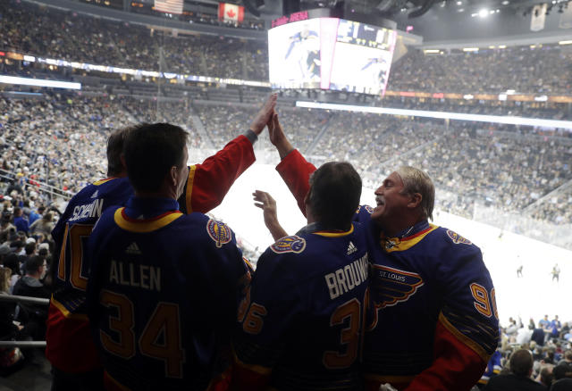 St. Louis Blues players' fathers react celebrate a Blues goal during the first period of the team's NHL hockey game against the Vegas Golden Knights on Thursday, Feb. 13, 2020, in Las Vegas. (AP Photo/Isaac Brekken)