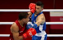 <p>Rohan Polanco Emiliano (L) of Dominican Republic exchanges punches with Bobo Usmon Baturov of Uzbekistan during the Men's Welter (63-69kg) on day four of the Tokyo 2020 Olympic Games at Kokugikan Arena on July 27, 2021 in Tokyo, Japan. (Photo by James Chance/Getty Images)</p>