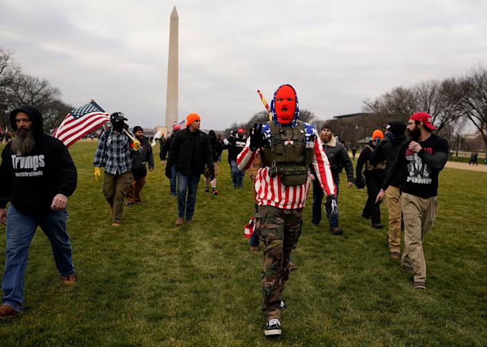 People march with those who say they are members of the Proud Boys in Washington on Jan. 6 in support of President Donald Trump.