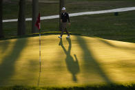 Harris English, of the United States, walks onto the 18th green during the third round of the US Open Golf Championship, Saturday, Sept. 19, 2020, in Mamaroneck, N.Y. (AP Photo/Charles Krupa)