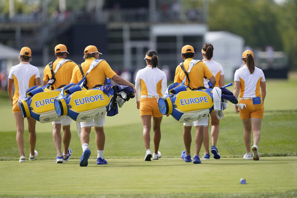 The European group of Celine Boutier, Georgia Hall, Leona Maguire, and Mel Reid walk to the green during practice for the Solheim Cup golf tournament, Friday, Sept. 3, 2021, in Toledo, Ohio. (AP Photo/Carlos Osorio)