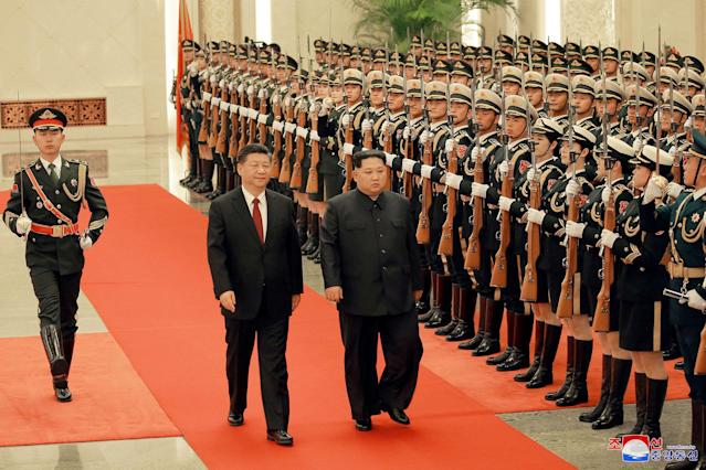 <p>North Korean leader Kim Jong Un and Chinese President Xi Jinping inspect honor guards in Beijing, as he paid an unofficial visit to China, in this undated photo released by North Korea's Korean Central News Agency (KCNA) in Pyongyang, March 28, 2018. (Photo: KCNA/via Reuters) </p>