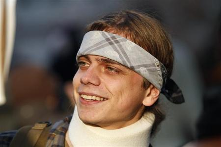 Marine veteran Scott Olsen, who suffered a head injury at the October 25 Occupy Oakland protest, smiles as he takes part in a demonstration in Oakland