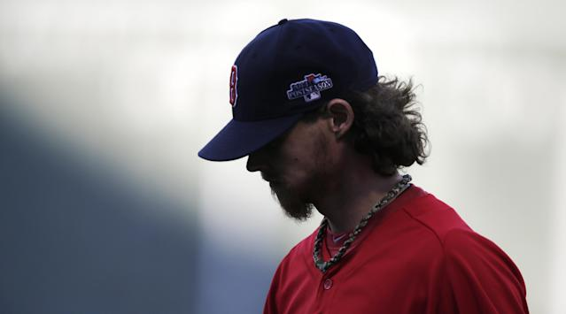 Boston Red Sox starting pitcher Clay Buchholz walks off the field after completing his workout at practice at Fenway Park, Friday, Oct. 18, 2013, in Boston. The Red Sox will face the Detroit Tigers in Game 6 of the American League baseball championship series on Saturday. (AP Photo/Charles Krupa)