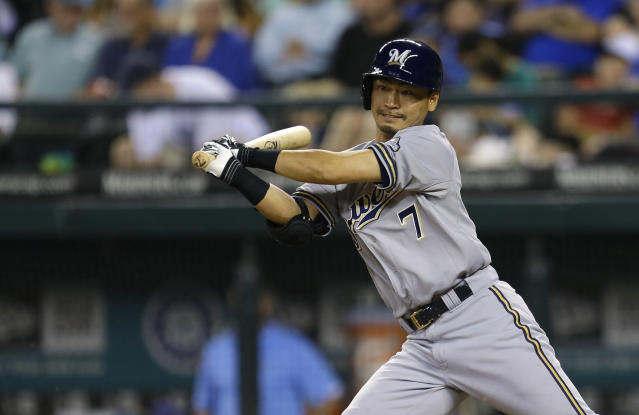 Milwaukee Brewers Norichika Aoki hits an RBI single in the fifth inning of a baseball game against the Seattle Mariners, Friday, Aug. 9, 2013, in Seattle. (AP Photo/Ted S. Warren)