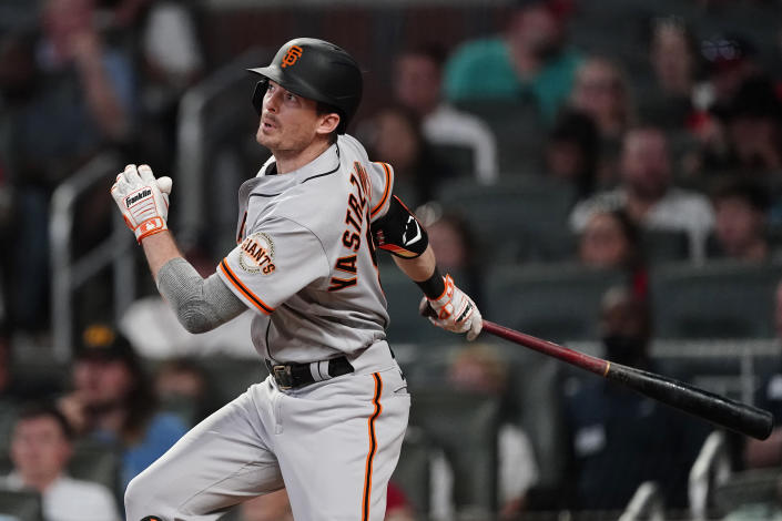 San Francisco Giants' Mike Yastrzemski drives in a run with a double in the eighth inning of a baseball game against the Atlanta Braves, Saturday, Aug. 28, 2021, in Atlanta. (AP Photo/John Bazemore)