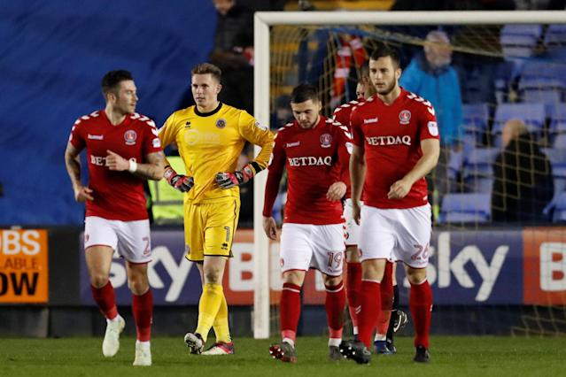 "Soccer Football - League One - Shrewsbury Town vs Charlton Athletic - Montgomery Waters Meadow, Shrewsbury, Britain - April 17, 2018 Shrewsbury Town's Dean Henderson looks dejected after Charlton's Josh Magennis (not pictured) scored their second goal Action Images/Andrew Boyers EDITORIAL USE ONLY. No use with unauthorized audio, video, data, fixture lists, club/league logos or ""live"" services. Online in-match use limited to 75 images, no video emulation. No use in betting, games or single club/league/player publications. Please contact your account representative for further details."