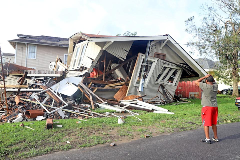 In New Orleans on Tuesday, Dartanian Stovall looks at a house that collapsed with him inside at the height of Hurricane Ida. He managed to crawl to safety.