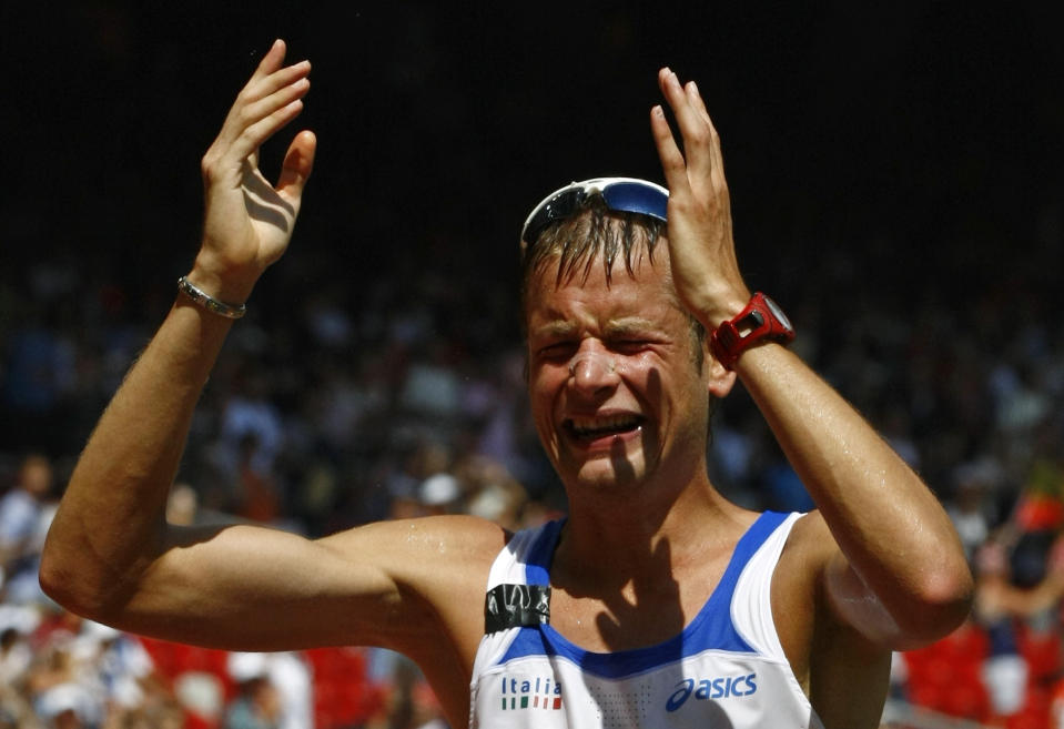 Alex Schwazer of Italy reacts after winning the men's 50km walk in the athletics competition of the Beijing 2008 Olympic Games in the National Stadium August 22, 2008.     REUTERS/Ruben Sprich (CHINA)