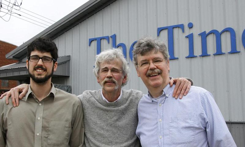 Art Cullen, centre, the 2017 winner of the Pulitzer prize for editorial writing, with his son, Tom and brother John