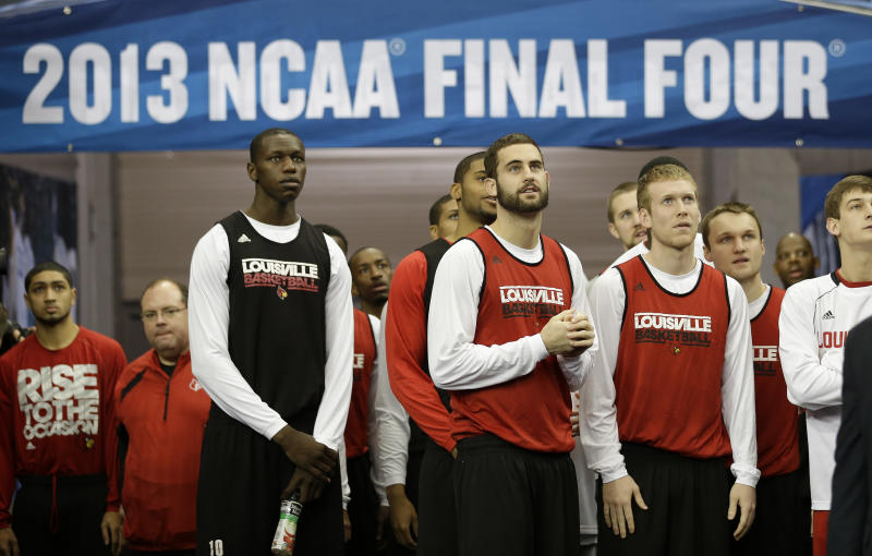 Louisville players enter the floor before practice for their NCAA Final Four tournament college basketball semifinal game against Wichita State, Friday, April 5, 2013, in Atlanta. Louisville plays Wichita State in a semifinal game on Saturday. (AP Photo/John Bazemore)