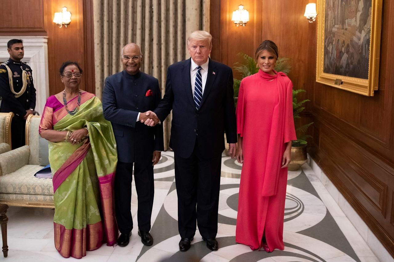 Indian President Ram Nath Kovind and his wife Savita Kovind stand with President Donald Trump and first lady Melania Trump as they arrive for a state banquet at Rashtrapati Bhavan, in New Delhi, India February 25, 2020. Alex Brandon/Pool via REUTERS