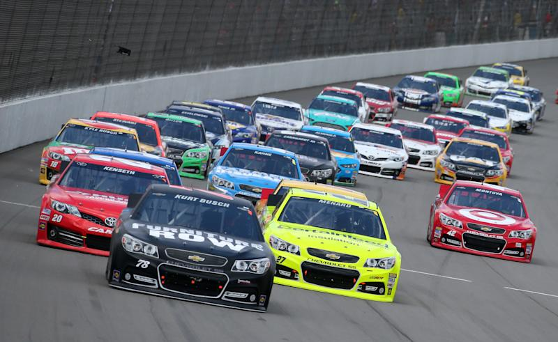 Sprint Cup Series driver Kurt Busch leads the field during the NASCAR Quicken Loans 400 auto race at Michigan International Speedway, Sunday, June 16, 2013 in Brooklyn, Mich. (AP Photo/Bob Brodbeck)