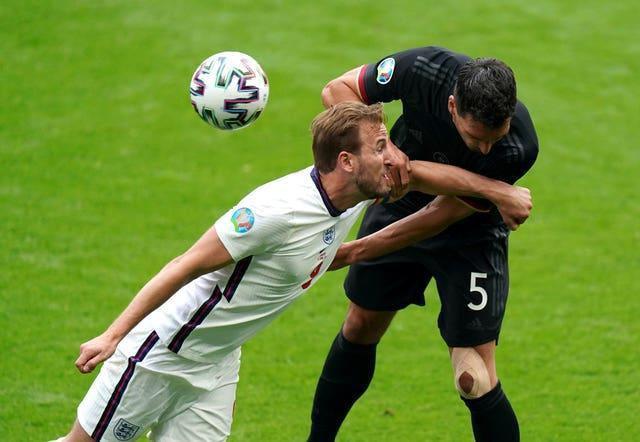 England's Harry Kane and Germany's Mats Hummels fight for the ball in the first half