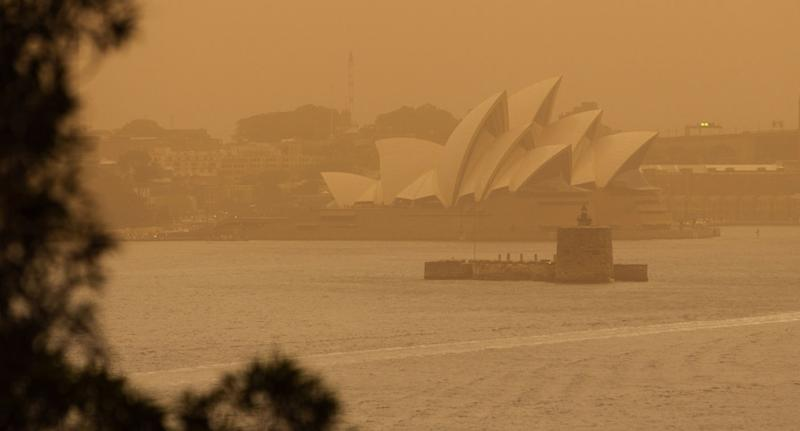 Smokey haze shown blanketing The Sydney Opera House amid bushfires across NSW Tuesday.