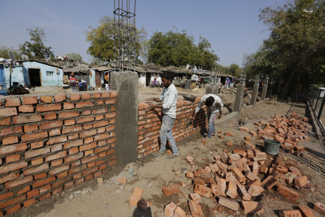 Image result for India Builds Wall Along Slum Ahead of Trump Visit