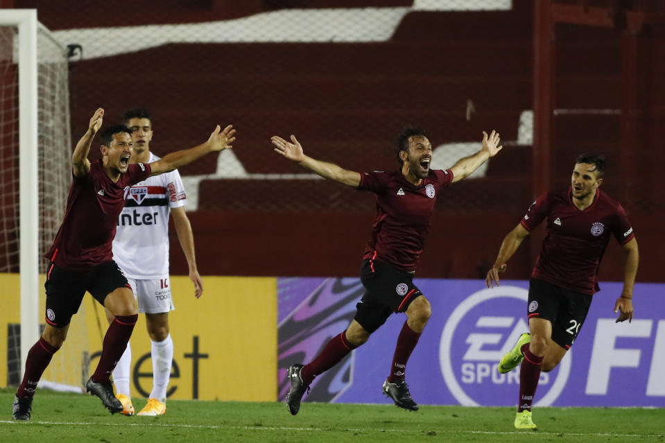 Argentina's Lanus midfielder Facundo Quignon (C) celebrates after scoring against Brazil's Sao Paulo during the closed-door Copa Sudamericana second round football match at the La Fortaleza stadium in Lanus, Buenos Aires Province, on October 28, 2020, amid the COVID-19 novel coronavirus pandemic. (Photo by AGUSTIN MARCARIAN / POOL / AFP) (Photo by AGUSTIN MARCARIAN/POOL/AFP via Getty Images)