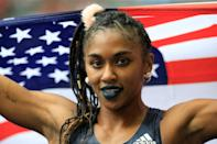 <p>Wearing a fuzzy pink scrunchie, dark-blue lipstick, and a braided ponytail at the 2018 ISTAF competition in Berlin.</p>