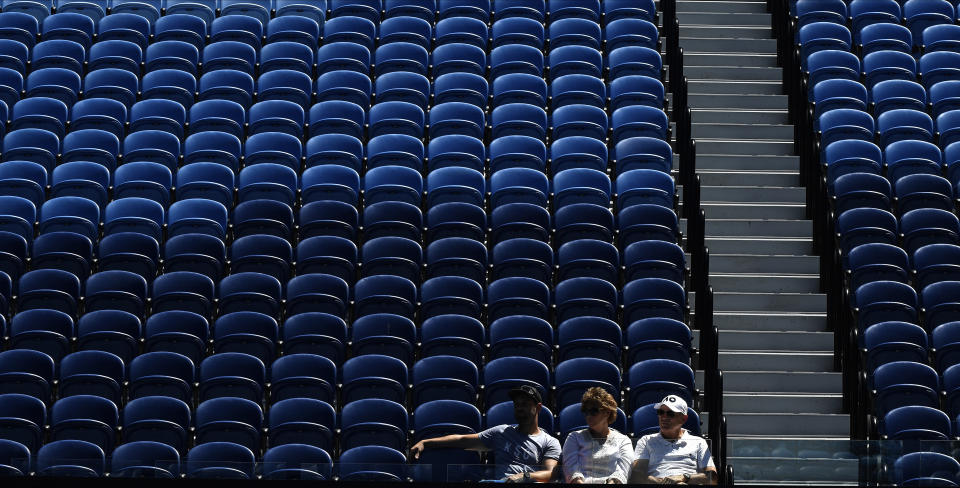 Spectators watch the third round match between United States' Serena Williams and Russia's Anastasia Potapova at the Australian Open tennis championship in Melbourne, Australia, Friday, Feb. 12, 2021.(AP Photo/Andy Brownbill)