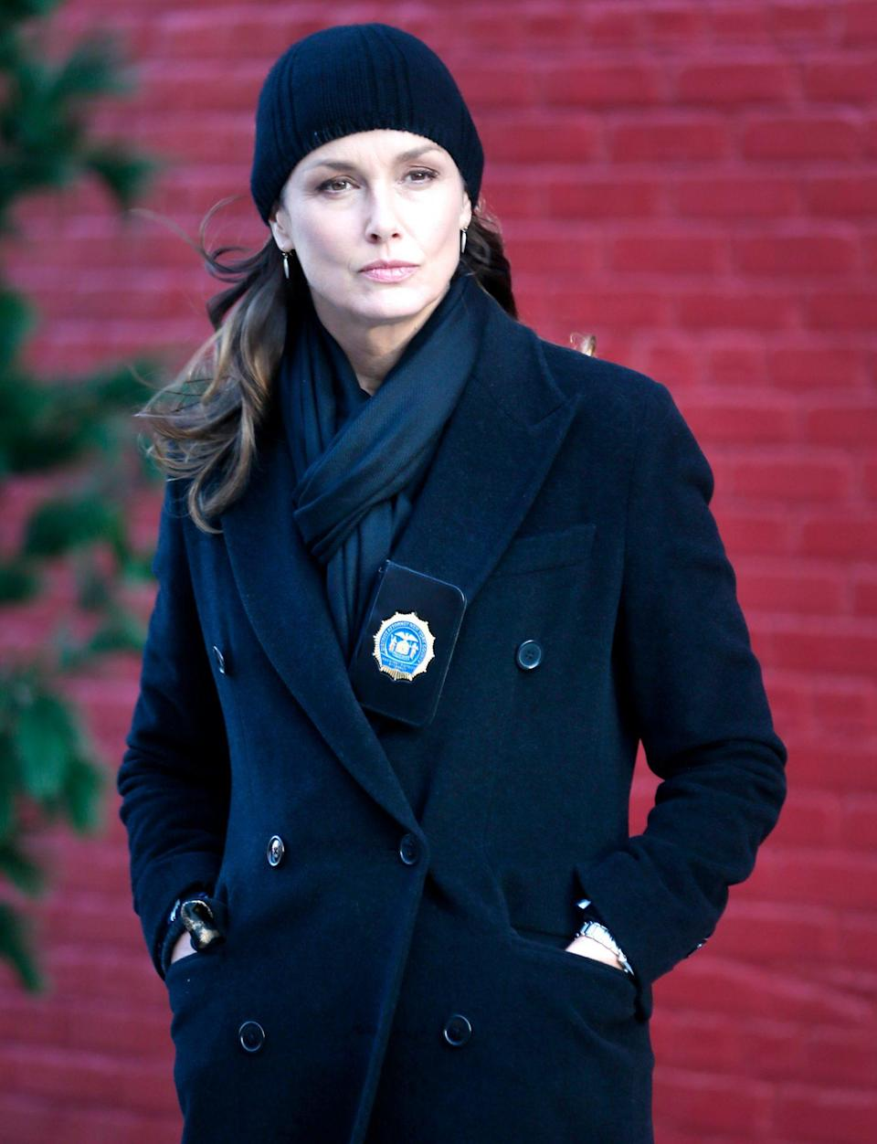 <p>Bridget Moynahan bundles up in a black jacket, scarf and beanie as she films a scene for <i>Blue Bloods </i>in N.Y.C. on Wednesday. </p>