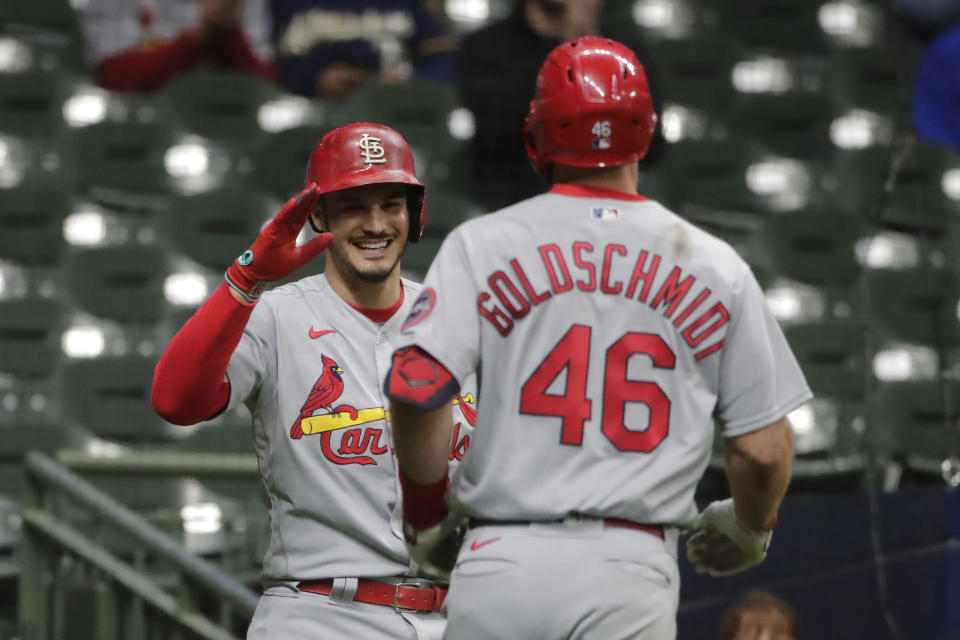 St. Louis Cardinals' Paul Goldschmidt (46) is congratulated by Nolan Arenado after hitting a two-run home run during the 11th inning of the team's baseball game against the Milwaukee Brewers on Tuesday, May 11, 2021, in Milwaukee. (AP Photo/Aaron Gash)