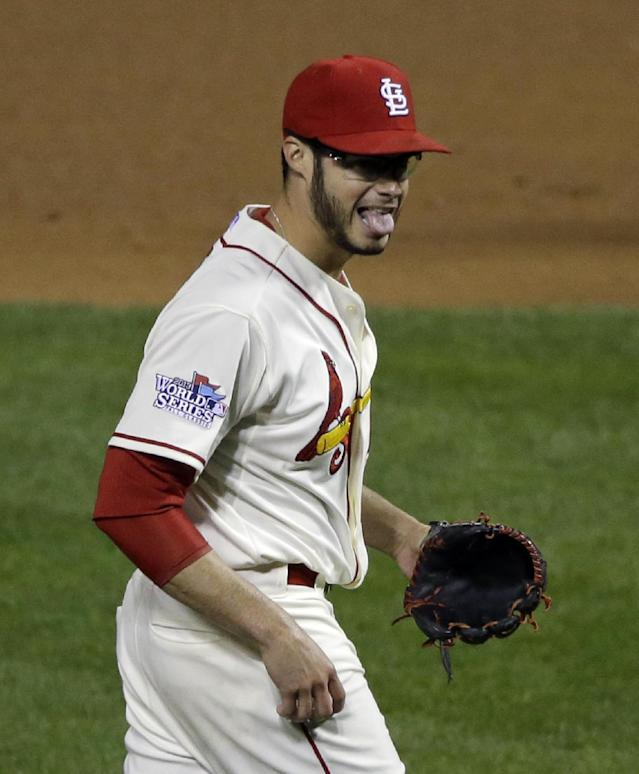 St. Louis Cardinals starting pitcher Joe Kelly reacts after striking out Boston Red Sox's Jacoby Ellsbury to end the top of the fifth inning of Game 3 of baseball's World Series Saturday, Oct. 26, 2013, in St. Louis. (AP Photo/Charlie Neibergall)