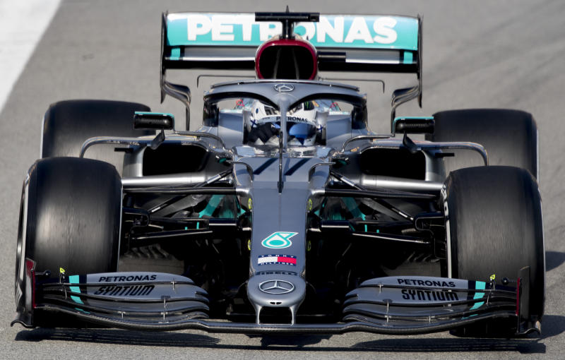 Mercedes-AMG Petronas' Valtteri Bottas steers his car during the Formula One pre-season testing session at the Barcelona Catalunya racetrack in Montmelo, outside Barcelona, Spain, Friday, Feb. 21, 2020. (AP Photo/Joan Monfort)