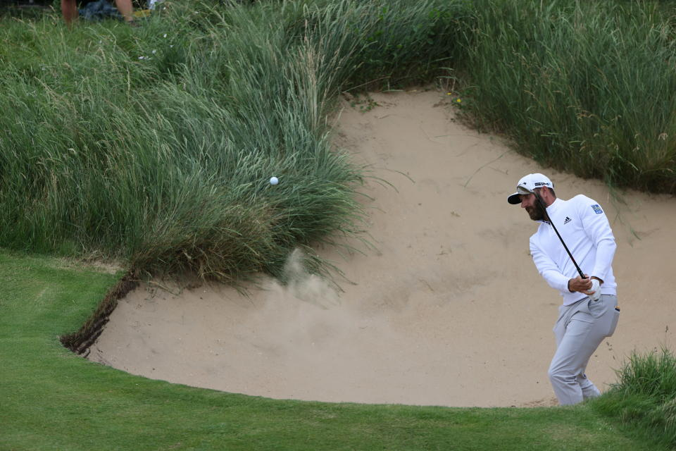 United States' Dustin Johnson hits out of a bunker on the 6th green during a practice round for the British Open Golf Championship at Royal St George's golf course Sandwich, England, Wednesday, July 14, 2021. The Open starts Thursday, July, 15. (AP Photo/Ian Walton)