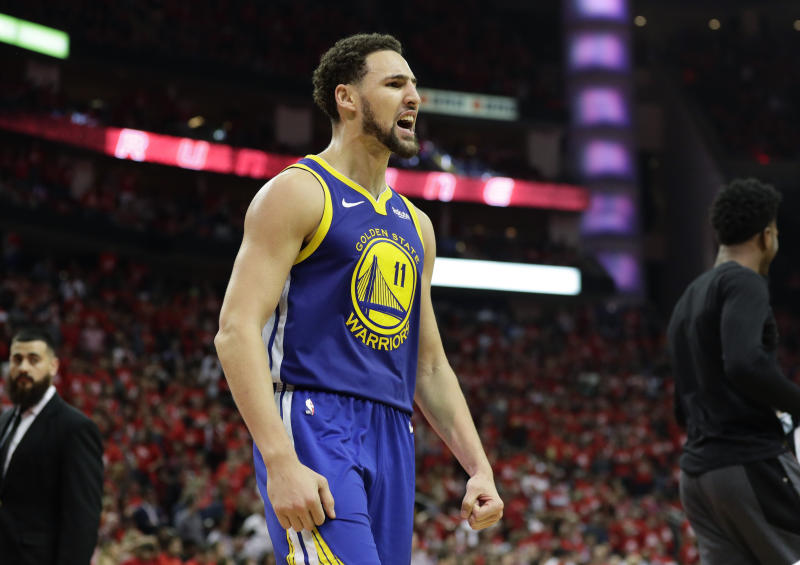 Golden State Warriors guard Klay Thompson celebrates the team's win over the Houston Rockets in Game 6 of a second-round NBA basketball playoff series Friday, May 10, 2019, in Houston. Golden State won 118-113, winning the series. (AP Photo/Eric Gay)
