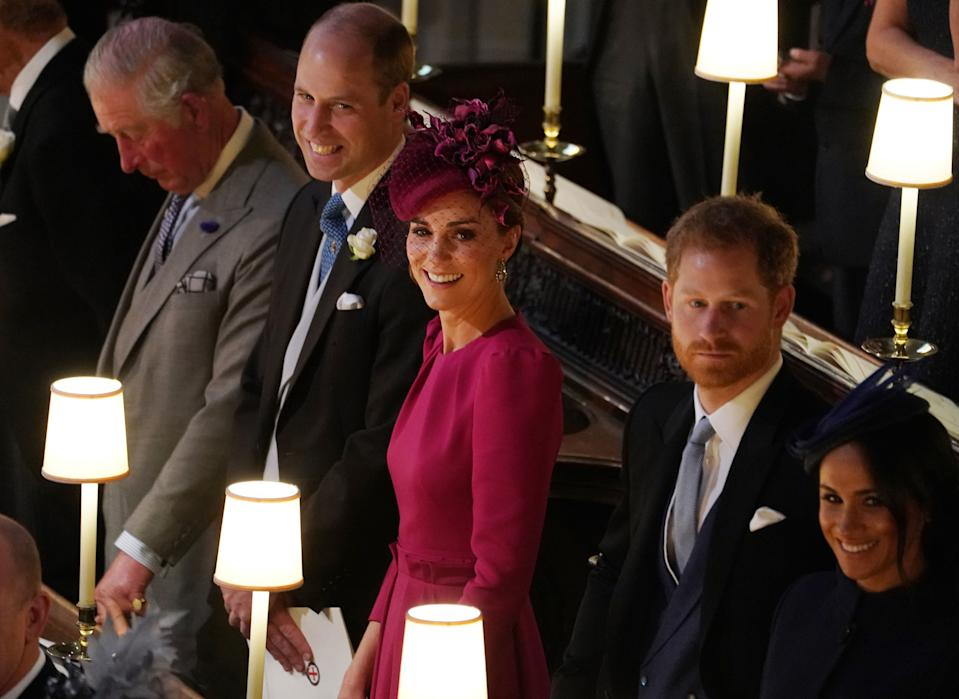 WINDSOR, ENGLAND - OCTOBER 12: Prince William, Duke of Cambridge Catherine, Duchess of Cambridge, Prince Harry, Duke of Sussex Meghan, Duchess of Sussex attend the wedding of Jack Brooksbank and Princess Eugenie of York at St. George's Chapel on October 12, 2018 in Windsor, England. (Photo by Owen Humphreys - WPA Pool/Getty Images)