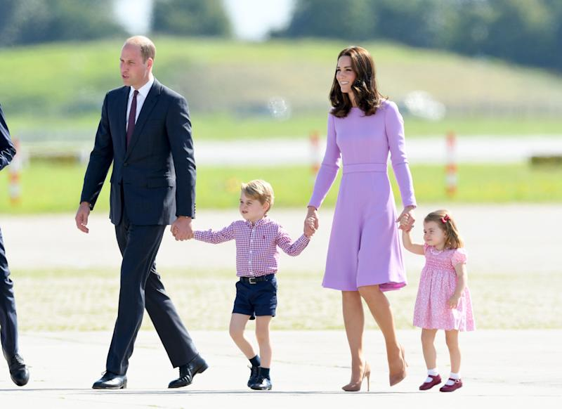 Prince George, Princess Charlotte of Cambridge and Catherine, Duchess of Cambridge coordinated in pastel pinks and purples before departing from Hamburg airport on the last day of their official visit to Poland and Germany on July 21, 2017.