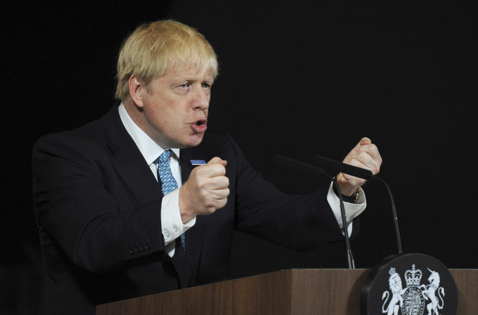"""FILE - In this July 27, 2019, file photo, Britain's Prime Minister Boris Johnson talks during a speech on domestic priorities at the Science and Industry Museum in Manchester, England. Johnson is gambling his future on the audacious proposition that he can blunt an effort to halt his Brexit plan by simply suspending """"the mother of all parliaments"""" for key weeks ahead of the Oct. 31 departure date. (AP Photo/Rui Vieira, File)"""