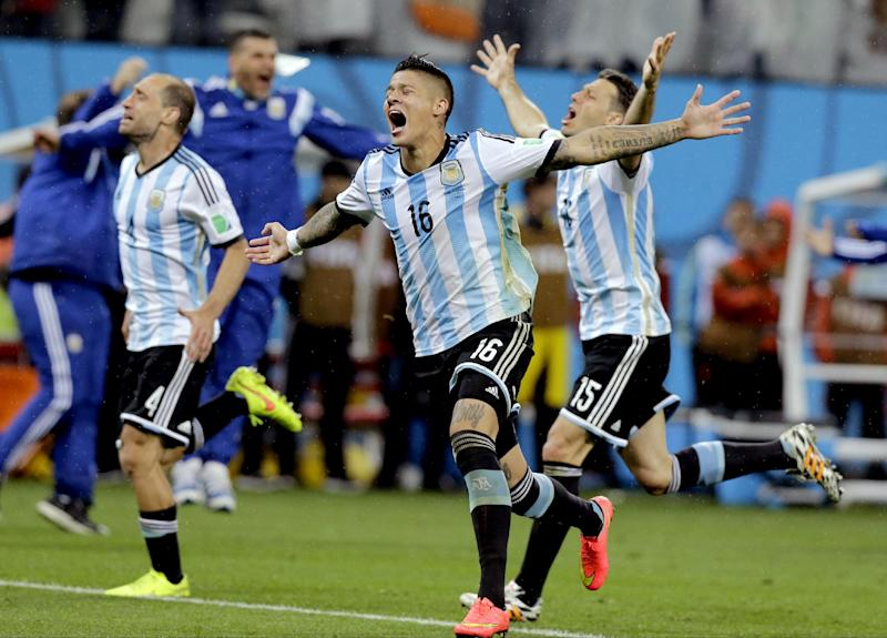 Argentine players react after Maxi Rodriguez scored the winning goal during a penalty shootout after extra time during the World Cup semifinal soccer match between the Netherlands and Argentina at the Itaquerao Stadium in Sao Paulo Brazil, Wednesday, July 9, 2014. Argentina defeated the Netherlands 4-2 in a penalty shootout after a 0-0 tie to advance to the finals. (AP Photo/Victor R. Caivano)