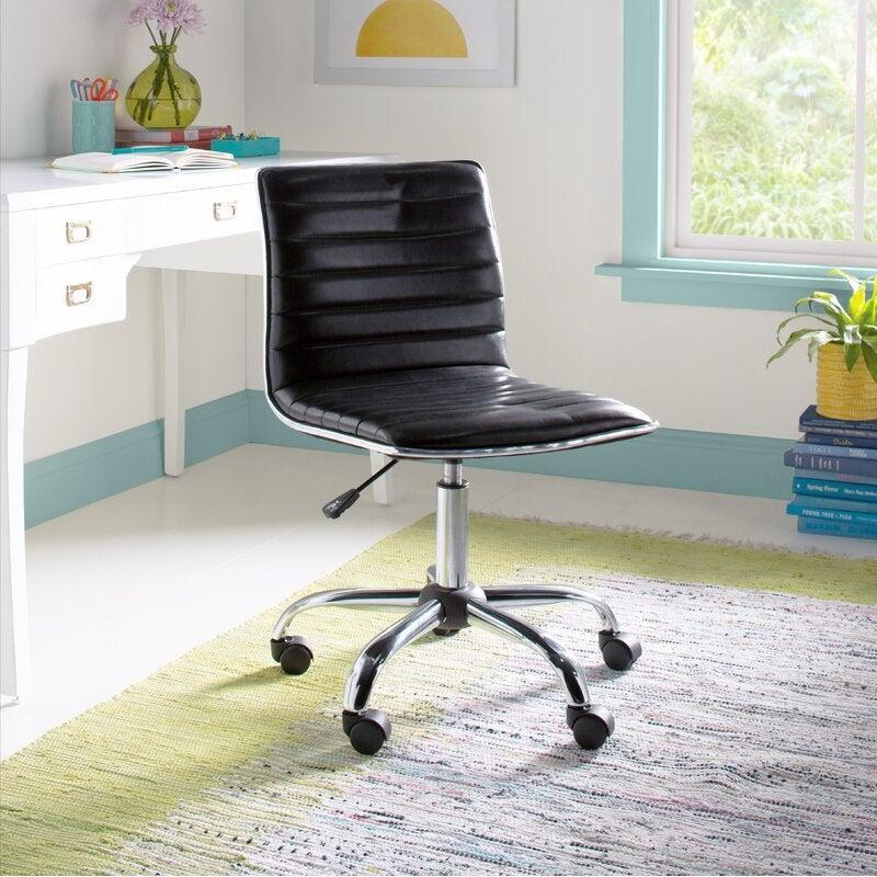 """<h2>Wayfair Basics Vinyl Task Chair</h2><br><strong>Best For: Budgets</strong><br>This contemporary desk chair is pretty straightforward in terms of streamlined style, but it still packs adjustable capabilities from wheels to a swivel seat and height all for under $100 buckeroos.<br><br><strong>The Hype: </strong>4.6 out of 5 stars and 895 reviews on <a href=""""https://www.wayfair.com/furniture/pdp/wayfair-basics-ochlocknee-vinyl-task-chair-w002998764.html"""" rel=""""nofollow noopener"""" target=""""_blank"""" data-ylk=""""slk:Wayfair"""" class=""""link rapid-noclick-resp"""">Wayfair</a><br><br><strong>Comfy Butts Say:</strong> """"Comfortable and strong. As a graphic designer, I spend a lot of time at my desk and have dealt with back pain before. This chair has great support while still looking minimalistic. I'd definitely recommend it!""""<br><br><strong>Wayfair Basics</strong> Ochlocknee Vinyl Task Chair, $, available at <a href=""""https://go.skimresources.com/?id=30283X879131&url=https%3A%2F%2Fwww.wayfair.com%2Ffurniture%2Fpdp%2Fwayfair-basics-ochlocknee-vinyl-task-chair-w002998764.html"""" rel=""""nofollow noopener"""" target=""""_blank"""" data-ylk=""""slk:Wayfair"""" class=""""link rapid-noclick-resp"""">Wayfair</a>"""