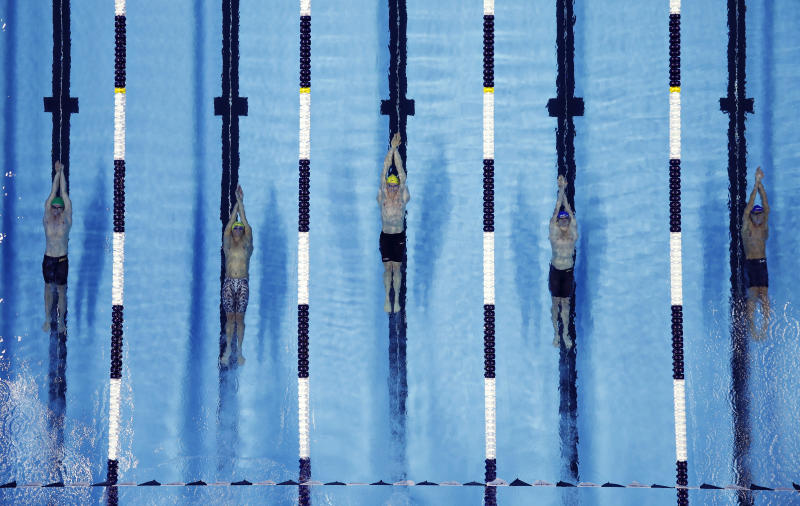 Swimmers compete in the men's 200-meter backstroke during an International Swimming League event Friday, Dec. 20, 2019, in Las Vegas. (AP Photo/John Locher)
