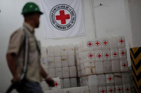 The logo of the International Federation of Red Cross is seen on boxes at the warehouse of Venezuelan Red Cross, where international humanitarian aid for Venezuela is being stored, in Caracas
