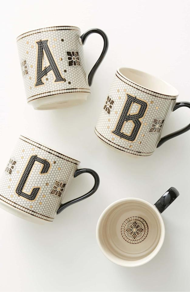 """<p>Get personal and treat her to this <a href=""""https://www.popsugar.com/buy/Anthropologie-Bistro-Monogram-Mug-500007?p_name=Anthropologie%20Bistro%20Monogram%20Mug&retailer=anthropologie.com&pid=500007&price=12&evar1=savvy%3Aus&evar9=32491647&evar98=https%3A%2F%2Fwww.popsugar.com%2Fsmart-living%2Fphoto-gallery%2F32491647%2Fimage%2F46700523%2FAnthropologie-Bistro-Monogram-Mug&list1=gifts%2Choliday%2Cgift%20guide%2Cbudget%20tips%2Choliday%20living%2Cgifts%20for%20women%2Cgifts%20under%20%24100%2Cgifts%20under%20%2450%2Cgifts%20under%20%2475&prop13=mobile&pdata=1"""" rel=""""nofollow"""" data-shoppable-link=""""1"""" target=""""_blank"""" class=""""ga-track"""" data-ga-category=""""Related"""" data-ga-label=""""https://www.anthropologie.com/shop/tiled-margot-monogram-mug?category=SEARCHRESULTS&amp;color=901"""" data-ga-action=""""In-Line Links"""">Anthropologie Bistro Monogram Mug</a> ($12).</p>"""