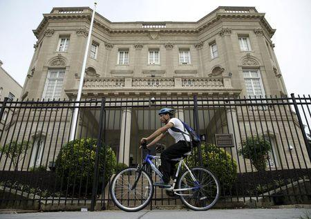 A cyclist pedals past the Cuban Interests Section is seen in Washington, July 1, 2015. REUTERS/Gary Cameron