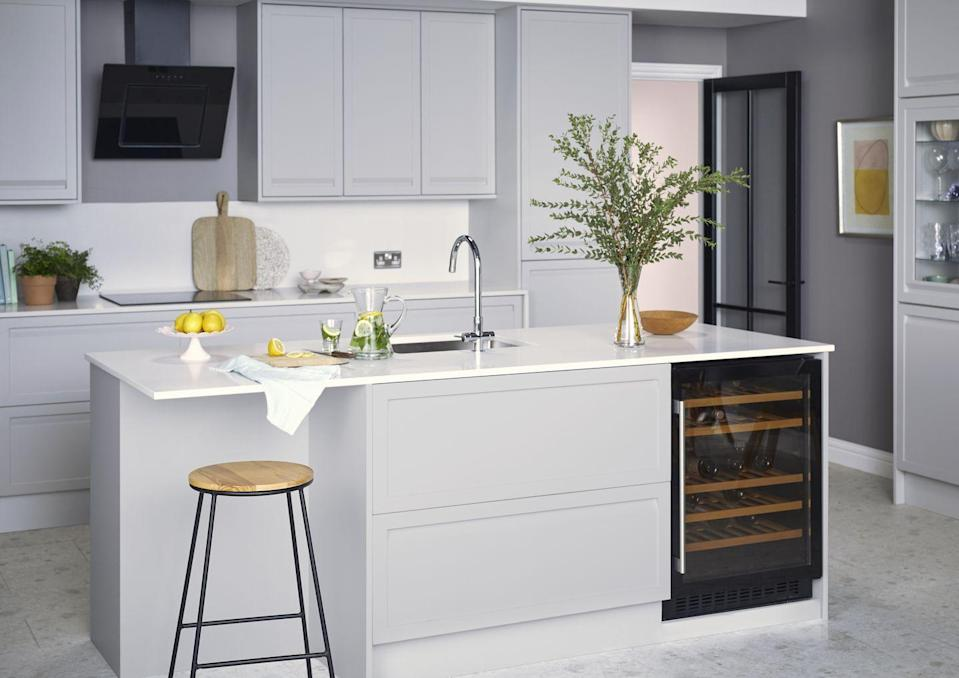 "<p>As a result of spending more time cooking and entertaining at home, there's now a greater investment in kitchen appliances. Many of us are incorporating wine storage into our kitchen design, without compromising on cabinet or other appliance space.</p><p>'Previously reserved for high end kitchens, but now with price led options available, young professionals who want to have separate storage for their wine, but also see it as a status symbol can quite easily find a wine cooler to fit their budget, kitchen style and size,' says Cem Kal, Kitchens at <a href=""https://www.miele.co.uk/"" rel=""nofollow noopener"" target=""_blank"" data-ylk=""slk:Miele GB"" class=""link rapid-noclick-resp"">Miele GB</a>. <br></p><p>Pictured: House Beautiful Westbourne Kitchen in Cobble, <a href=""https://www.homebase.co.uk/our-range/kitchens/kitchen-ranges/westbourne"" rel=""nofollow noopener"" target=""_blank"" data-ylk=""slk:Homebase"" class=""link rapid-noclick-resp"">Homebase</a></p>"