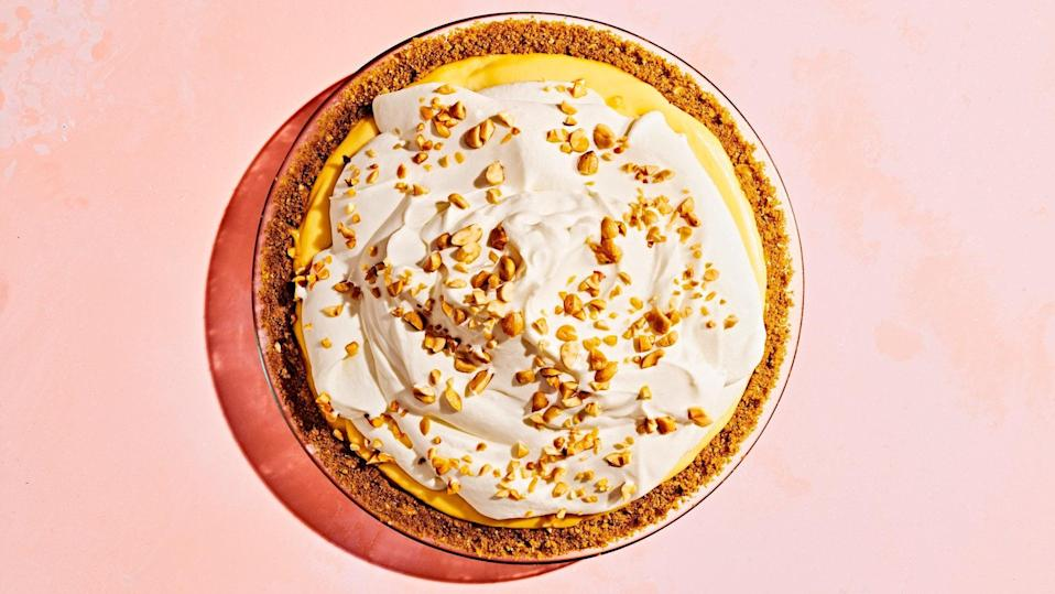 """Not your average banana cream pie. Here, salted, roasted peanuts add flavor to the graham cracker crust, and crunch to the top. <a href=""""https://www.epicurious.com/recipes/food/views/banana-cream-pie?mbid=synd_yahoo_rss"""" rel=""""nofollow noopener"""" target=""""_blank"""" data-ylk=""""slk:See recipe."""" class=""""link rapid-noclick-resp"""">See recipe.</a>"""