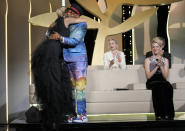 Director Julia Ducournau, left, hugs jury president Spike Lee after winning the Palme d'Or for her film 'Titane' during the awards ceremony at the 74th international film festival, Cannes, southern France, Saturday, July 17, 2021. (AP Photo/Vadim Ghirda)