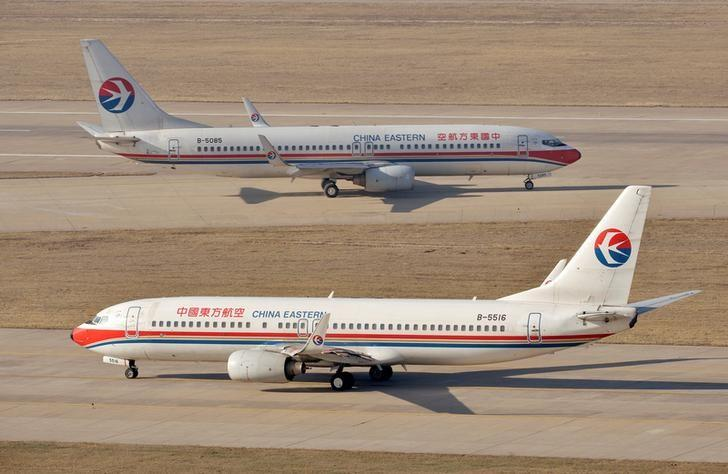 FILE PHOTO - China Eastern Airlines Boeing 737 planes are seen at an airport in Taiyuan