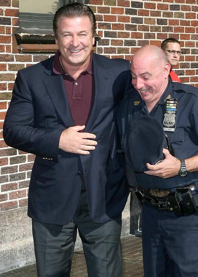 """""""30 Rock's"""" Alec Baldwin got up close and personal with one of New York City's finest before popping by to see Dave. Tyrone/<a href=""""http://www.x17online.com"""" target=""""new"""">X17 Online</a> - September 21, 2010"""