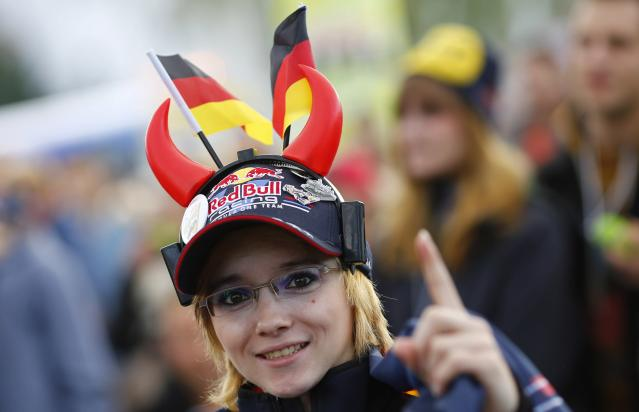 A supporter of Germany's Red Bull Formula One driver Sebastian Vettel reacts at the start of the Formula One Grand Prix of India in Dehli, at a public viewing session in Vettel's hometown of Heppenheim, southwestern Germany, October 27, 2013. REUTERS/Kai Pfaffenbach (GERMANY - Tags: SPORT MOTORSPORT SOCIETY)