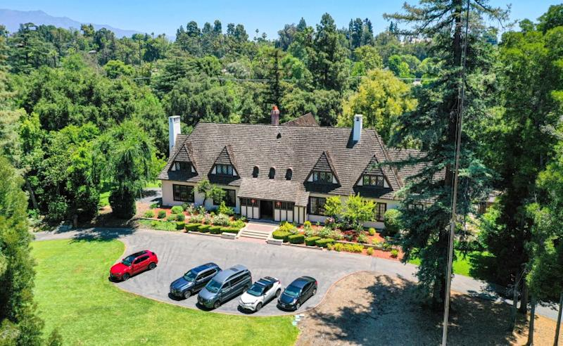 The 3.5-acre spread include a swimming pool, tennis court, rose garden and an English Country home built in 1915.