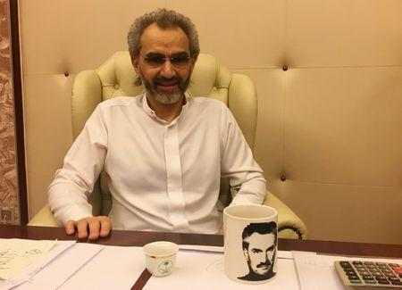 Saudi Arabian billionaire Prince Alwaleed bin Talal sits for an interview with Reuters in the office of the suite where he has been detained at the Ritz-Carlton in Riyadh, Saudi Arabia