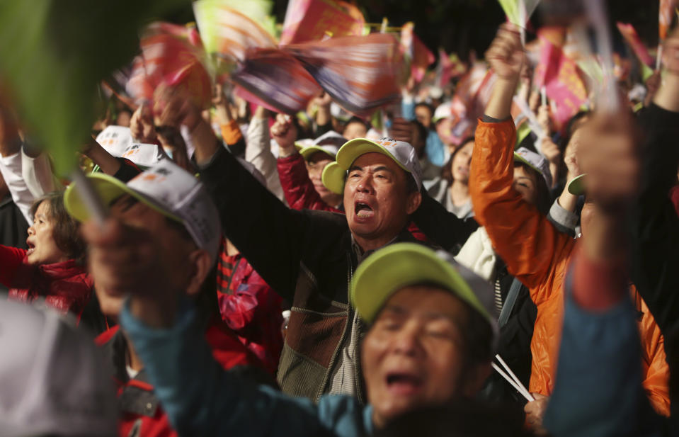 Supporters of Taiwan's 2020 presidential election candidate, Taiwan president Tsai Ing-wen of the Democratic Progressive Party (DPP), cheer during a campaign rally in Taipei, Taiwan, Sunday, Jan. 5, 2020. Taiwan will hold its presidential election on Jan. 11, 2020. (AP Photo/Chiang Ying-ying)